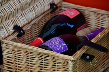 Wicker hamper with one bottle of Renegade and Longton pure elderflower sparkling wine and one bottle of Renegade and Longton blush elderflower and rhubarb sparkling wine