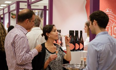 Trade show customer sampling Renegade and Longton blush elderflower and rhubarb sparkling wine