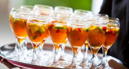 Lots of glasses of a Pimm's wedding cocktail on a silver platter