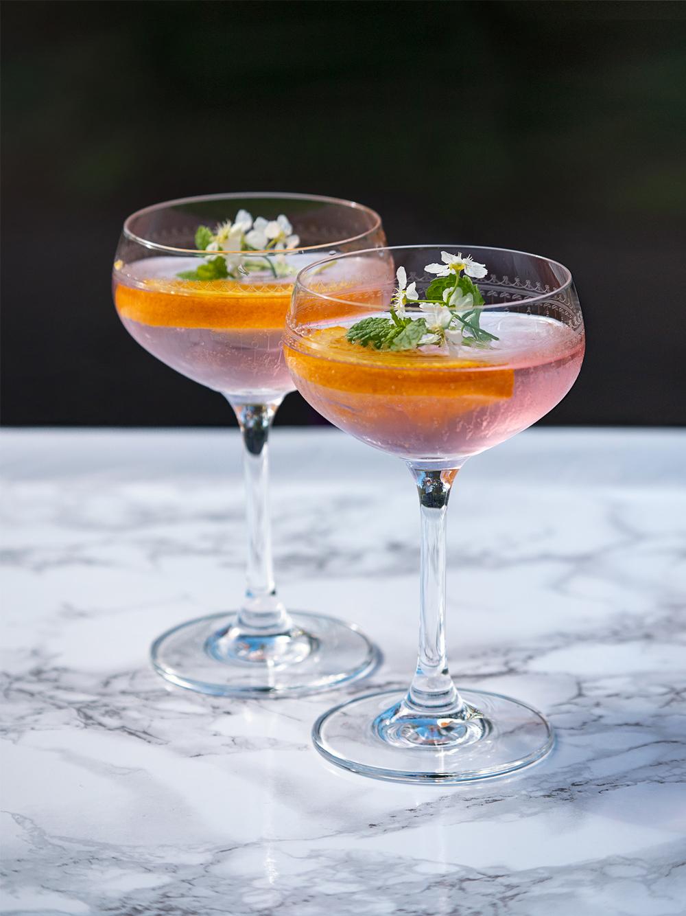 two glasses of an Elderflower Wine Aperol Spritz