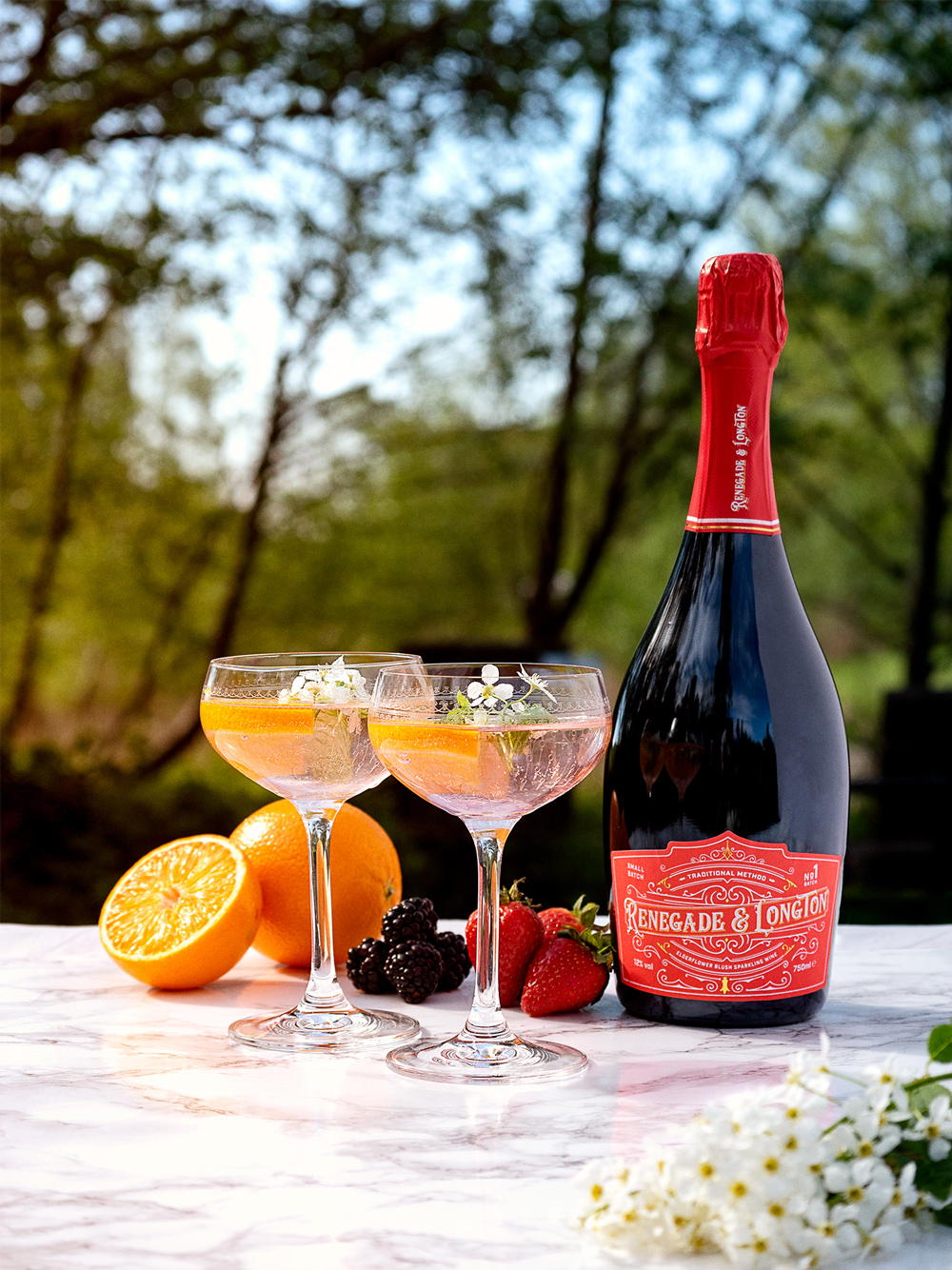 two glasses of rhubarb wine Aperol spritz and a bottle of Renegade and Longton blush elderflower sparkling wine