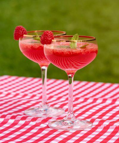 Two glasses of a elderflower wine Raspberry Fizz
