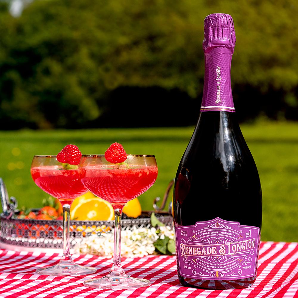 Two glasses of elderflower wine raspberry fizz and a bottle of Renegade and Longton pure elderflower sparkling wine