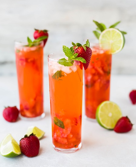 Three glasses filled with a Vegan cocktail Pimms Royale