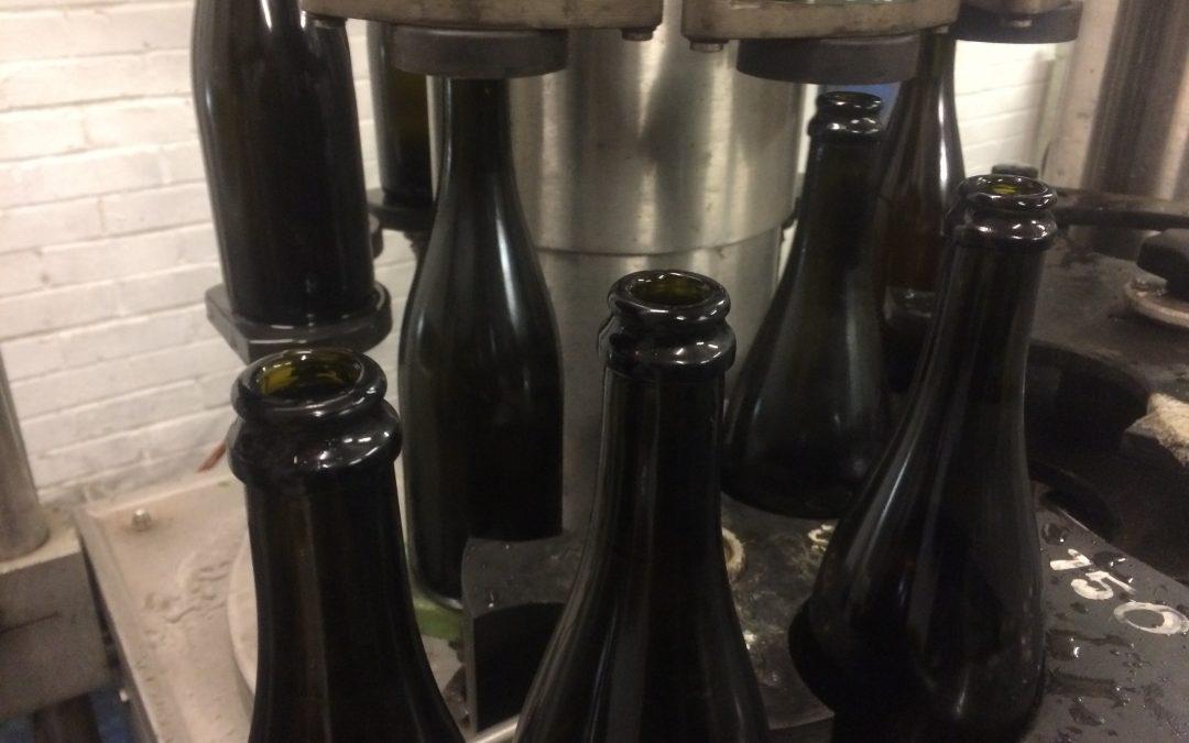 Sparkling wine bottles being filled for the second fermentation