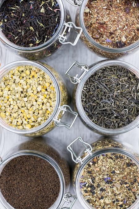 Six jars of dried elderflowers ready for elderflower wine making
