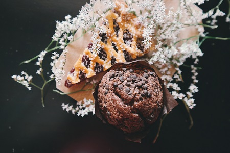 Muffin and pie both made with elderflower and decorated with elderflowers
