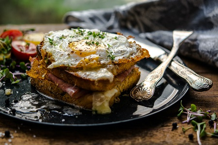 Croque monsieur with fried egg prepared to be served with an elderflower wine