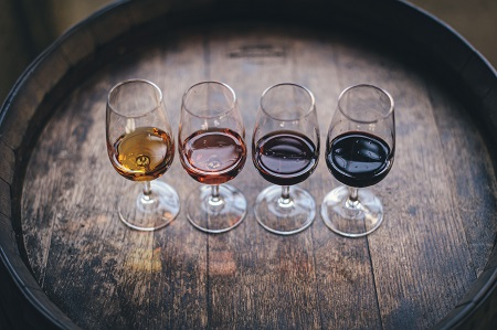 Four glasses of wine ready for sampling